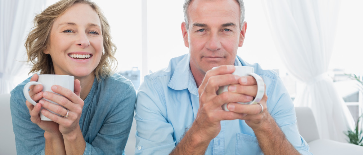 http://www.dreamstime.com/royalty-free-stock-images-content-middle-aged-couple-sitting-couch-having-coffee-smiling-camera-home-living-room-image32879459